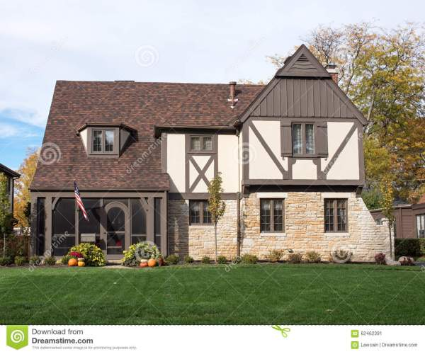 English Tudor Home With American Flag & Pumpkins Stock