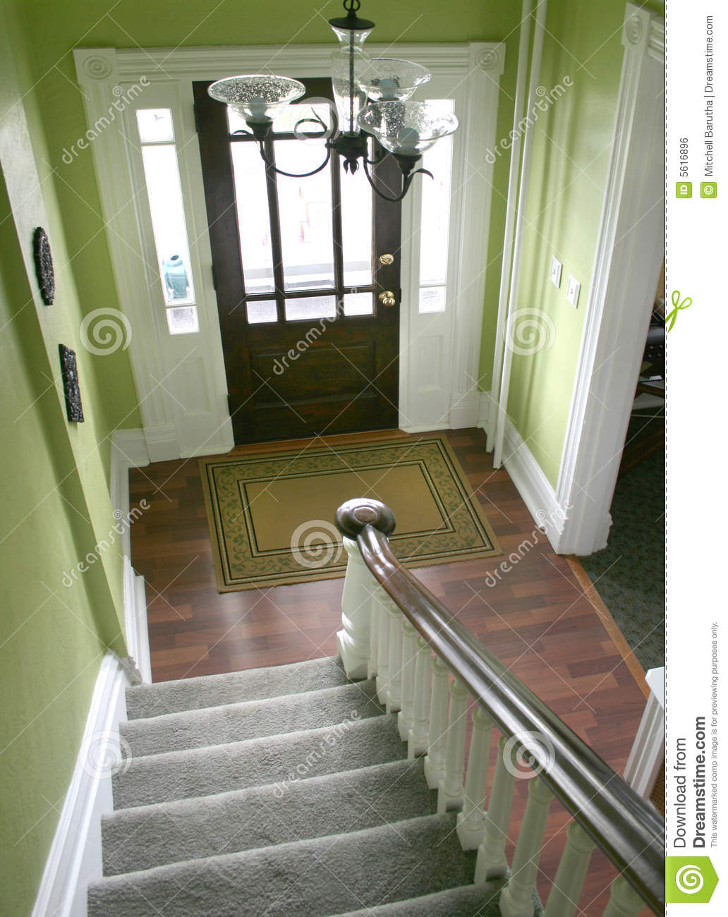 Entry Hall Stairs And Front Door Royalty Free Stock Image