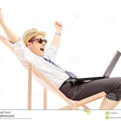 Sitting Chair Lafuma Futura Xl Zero Gravity Excited Man With Laptop On A Beach Stock