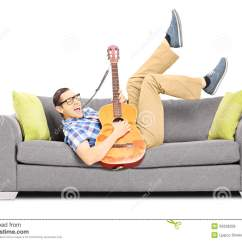 Guitar Playing Chair Sheepskin Rug On Excited Young Male Lying A Sofa And