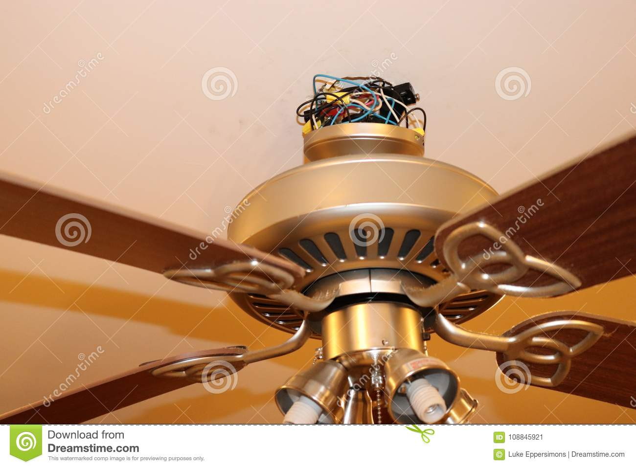 hight resolution of exposed ceiling fan wires closeup fan is hanging from ceiling in picture