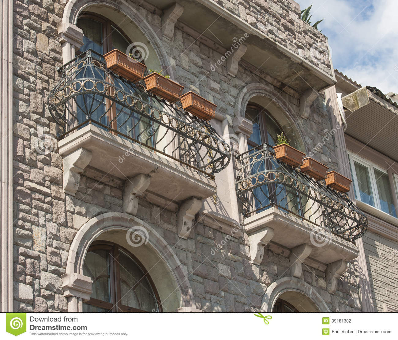 Exterior Of A Stone Building With Balcony Stock Photo