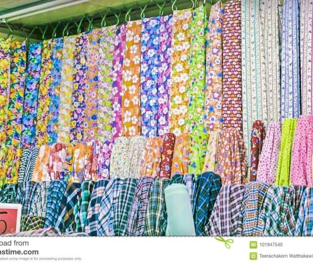 Fabric Store Traditional Fabric Store With Stacks Of Colorful Textiles Fabric Rolls At Market Stall Textile Industry Background With Blurred