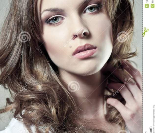 Closeup Portrait Of A Young Woman With Natural Makeup And Perfect