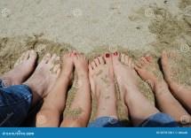 Family Feet Beach Stock - 29761361