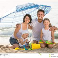 Children S Beach Chair With Umbrella Ikea Klappsta Covers Family Of Four Sitting Together Under On