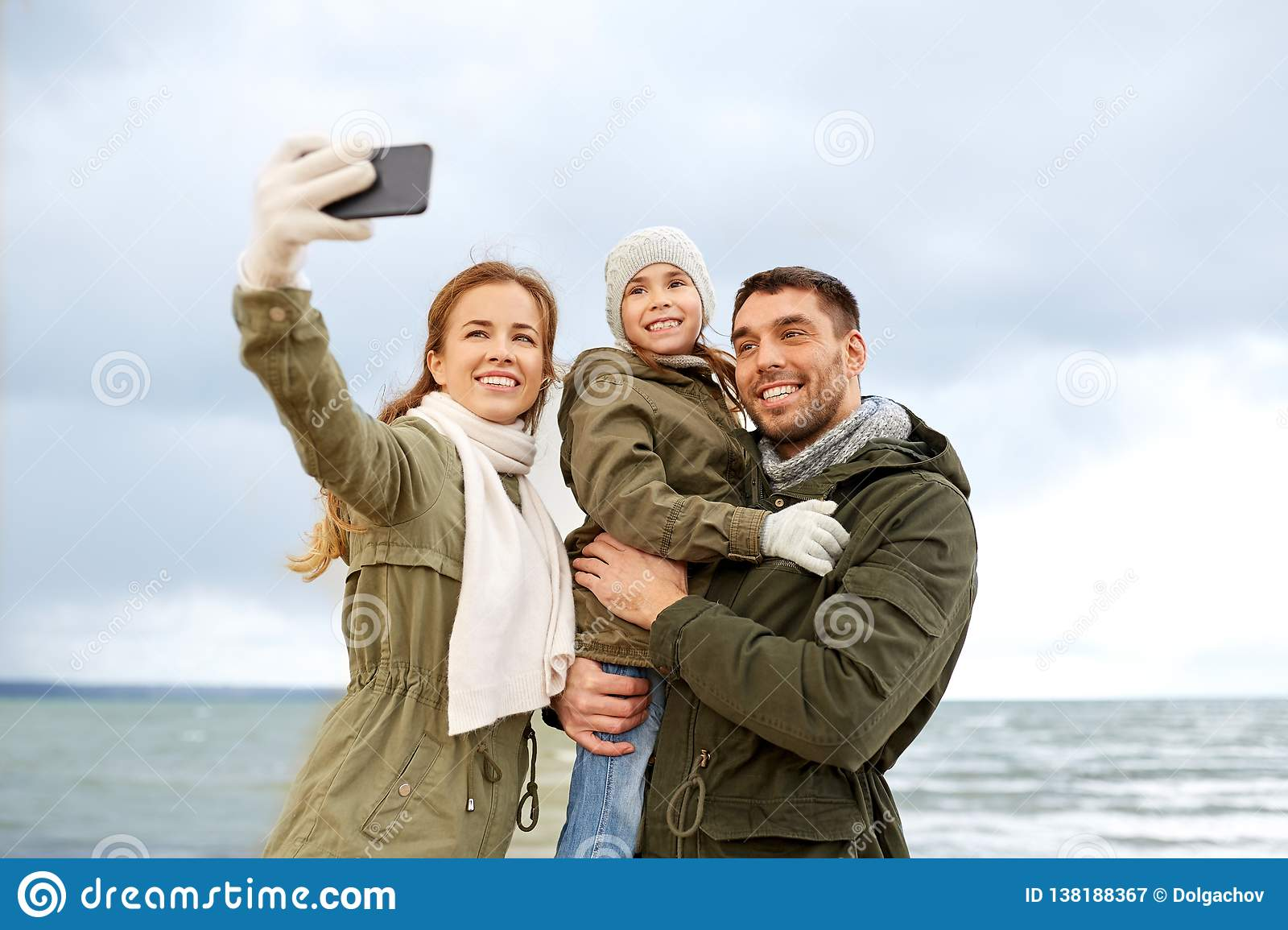 family taking selfie by