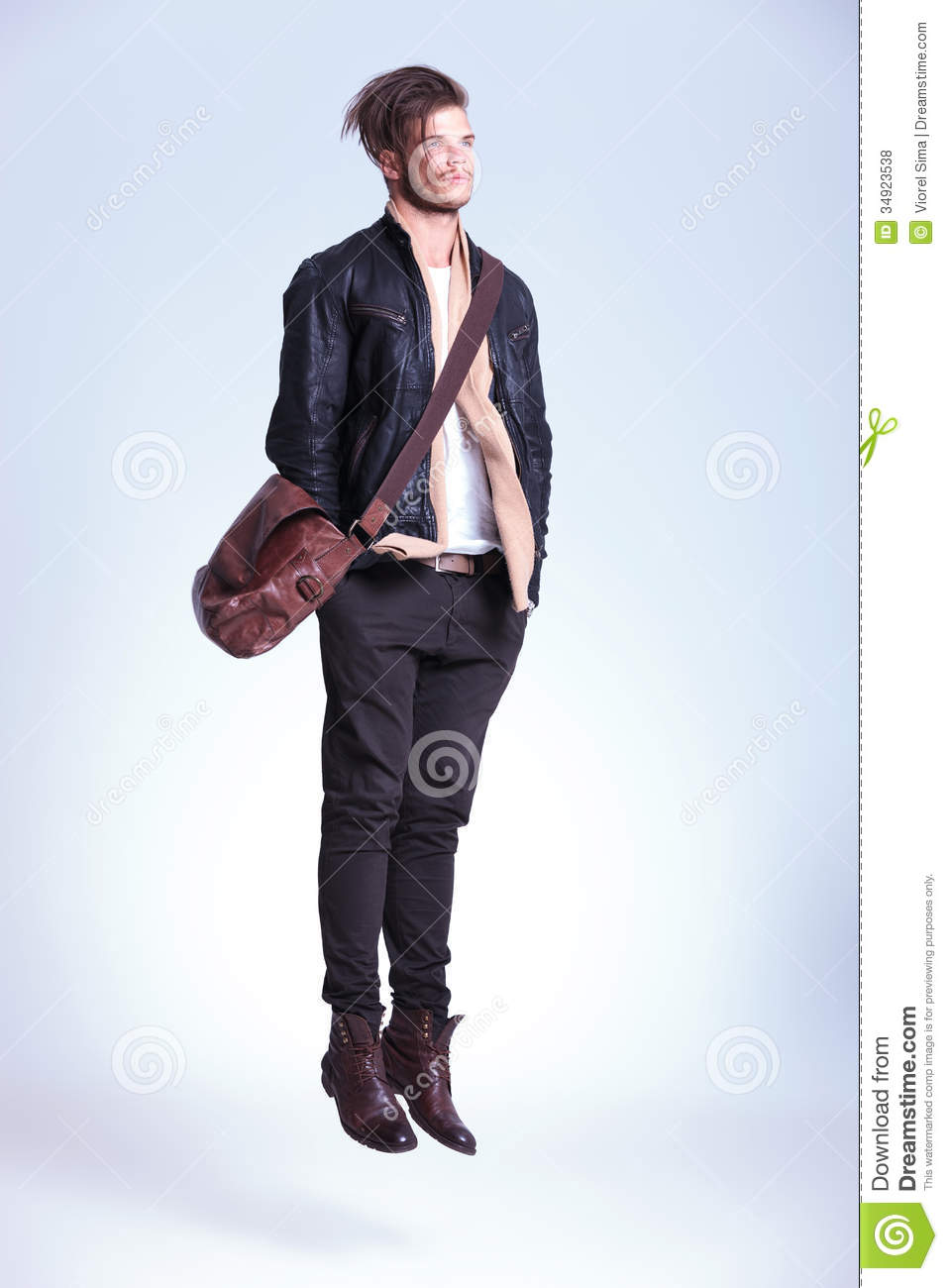 Fashion Man With Hands In Pockets Is Jumping Royalty Free