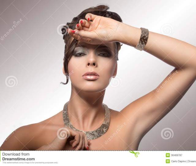 Brown Woman In Fashion Pose With Curly Hairdo Cute Make Up Nacked Shoulder And Jewelery On White Background