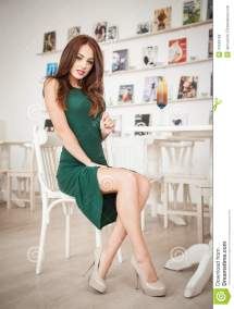 Attractive Woman Sitting in Green Dress