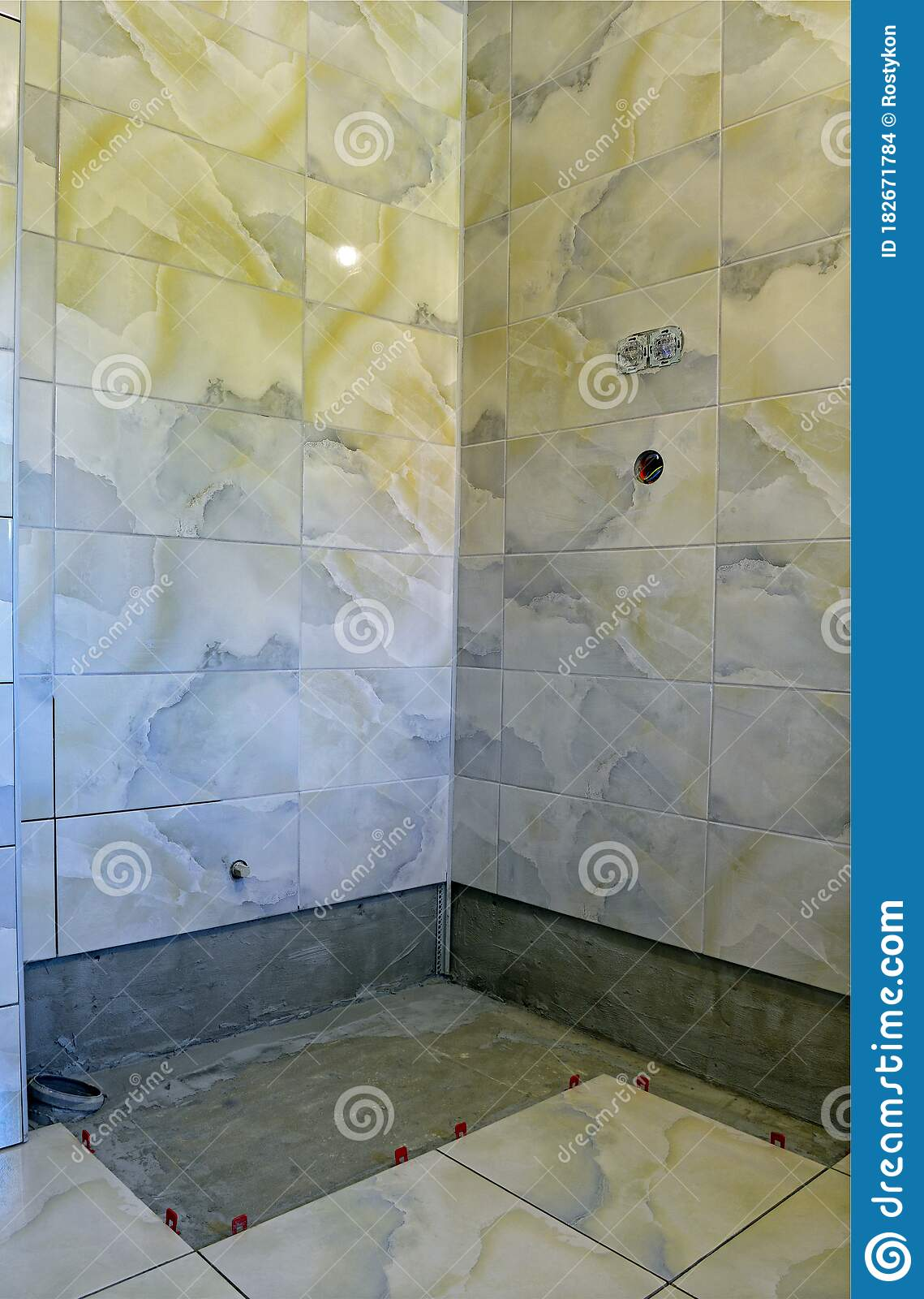 fastening of a ceramic tile to walls and a floor stock photo image of perpendicular background 182671784