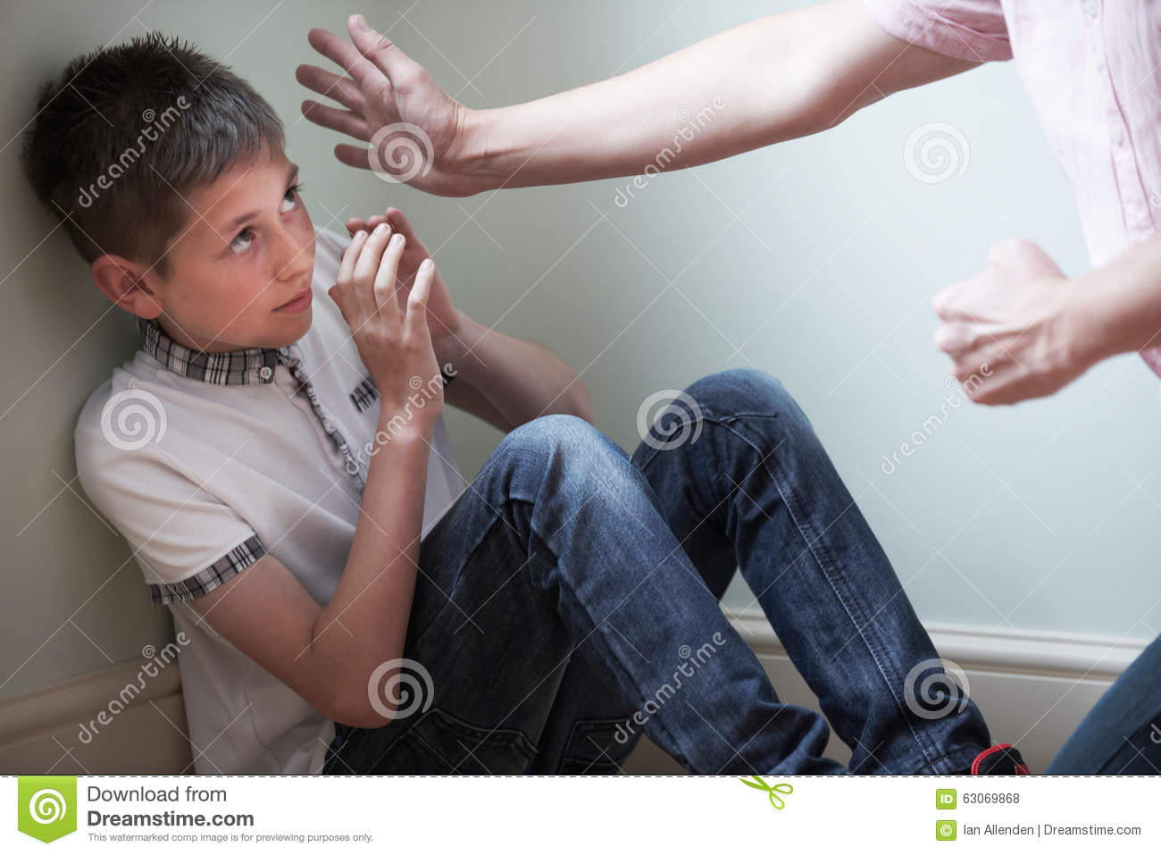 Father Being Physically Abusive Towards Son Stock Photo