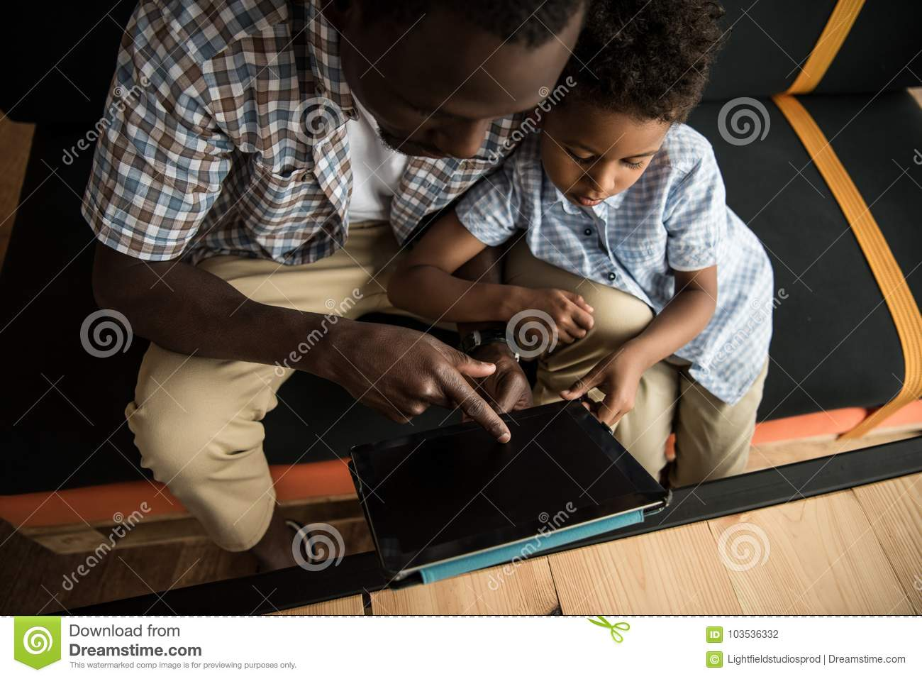 Father And Son With Digital Tablet Stock Photo