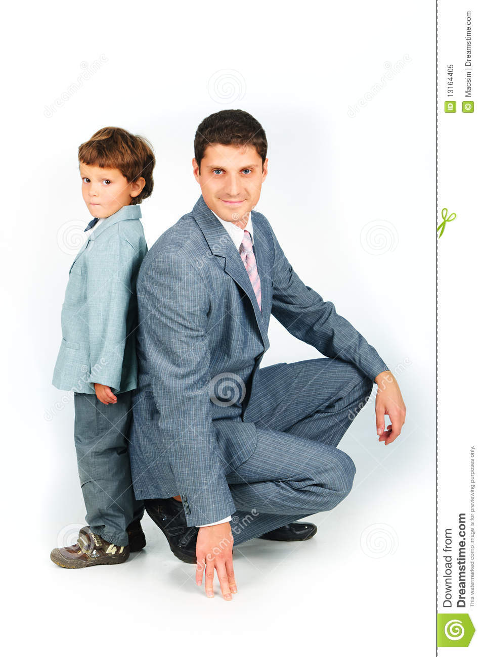 Father With A Son Dressed In A Suit Royalty Free Stock