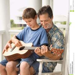 Best Chair For Guitar Playing Accent Chairs Blue Father And Son Stock Photo Image Of