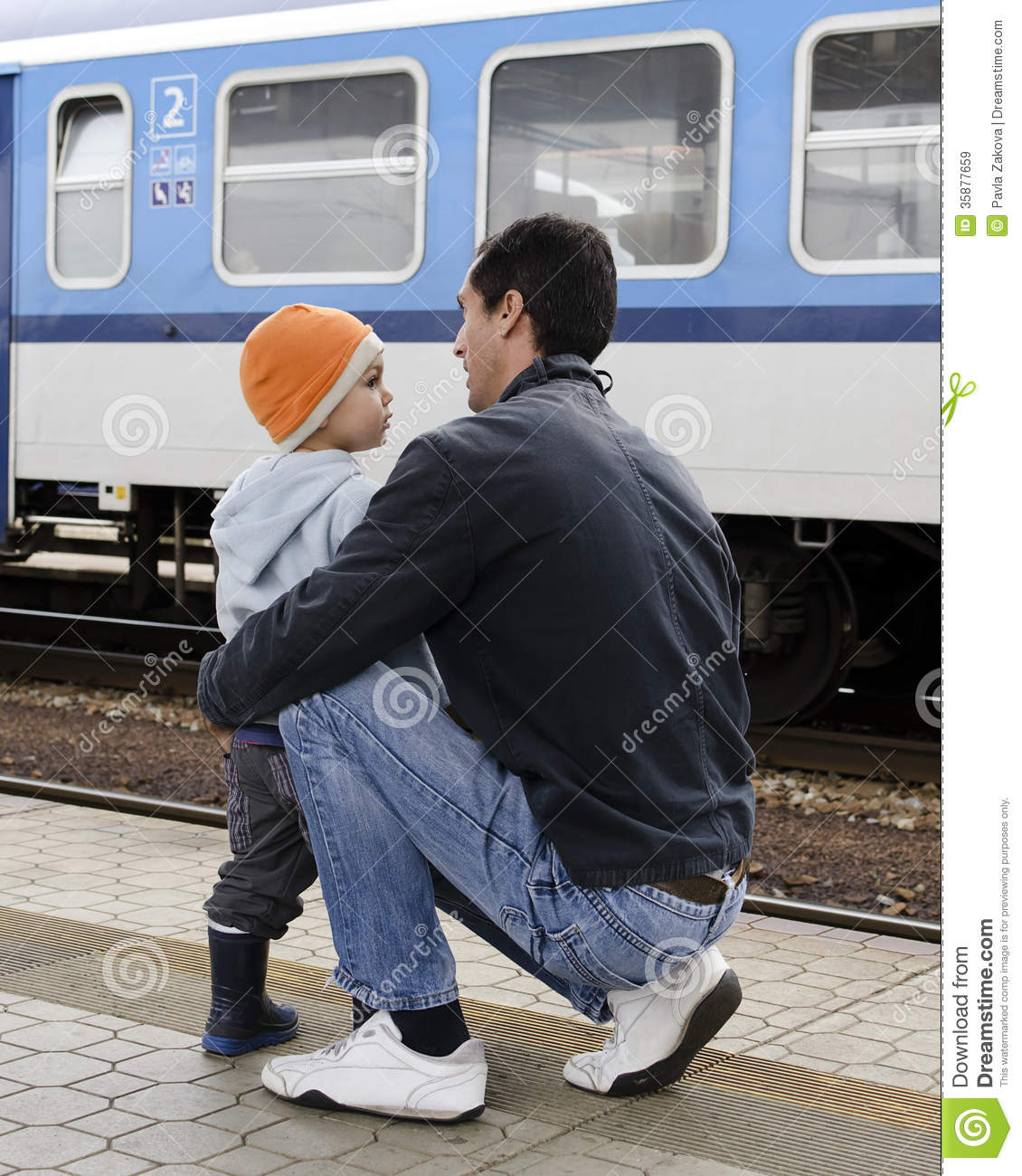 Father And Son At Train Station Stock Image