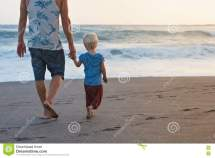 Father And Son Walk Seaside Royalty-free Stock