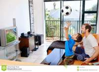 Father And Son Watching Tv Together Stock Photo - Image ...