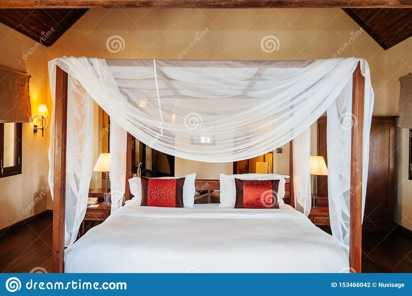 https www dreamstime com feb dalat vietnam asian tropical bedroom wooden four poster bed white curtain colourful pillows furnished old wood table image153466042