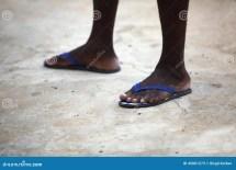 Feet Of African Man In Blue Flip Flops Stock