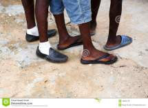 Feet Of African Men In Shoes Stock