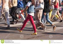 Feet Of Pedestrians Crossing City Street Stock