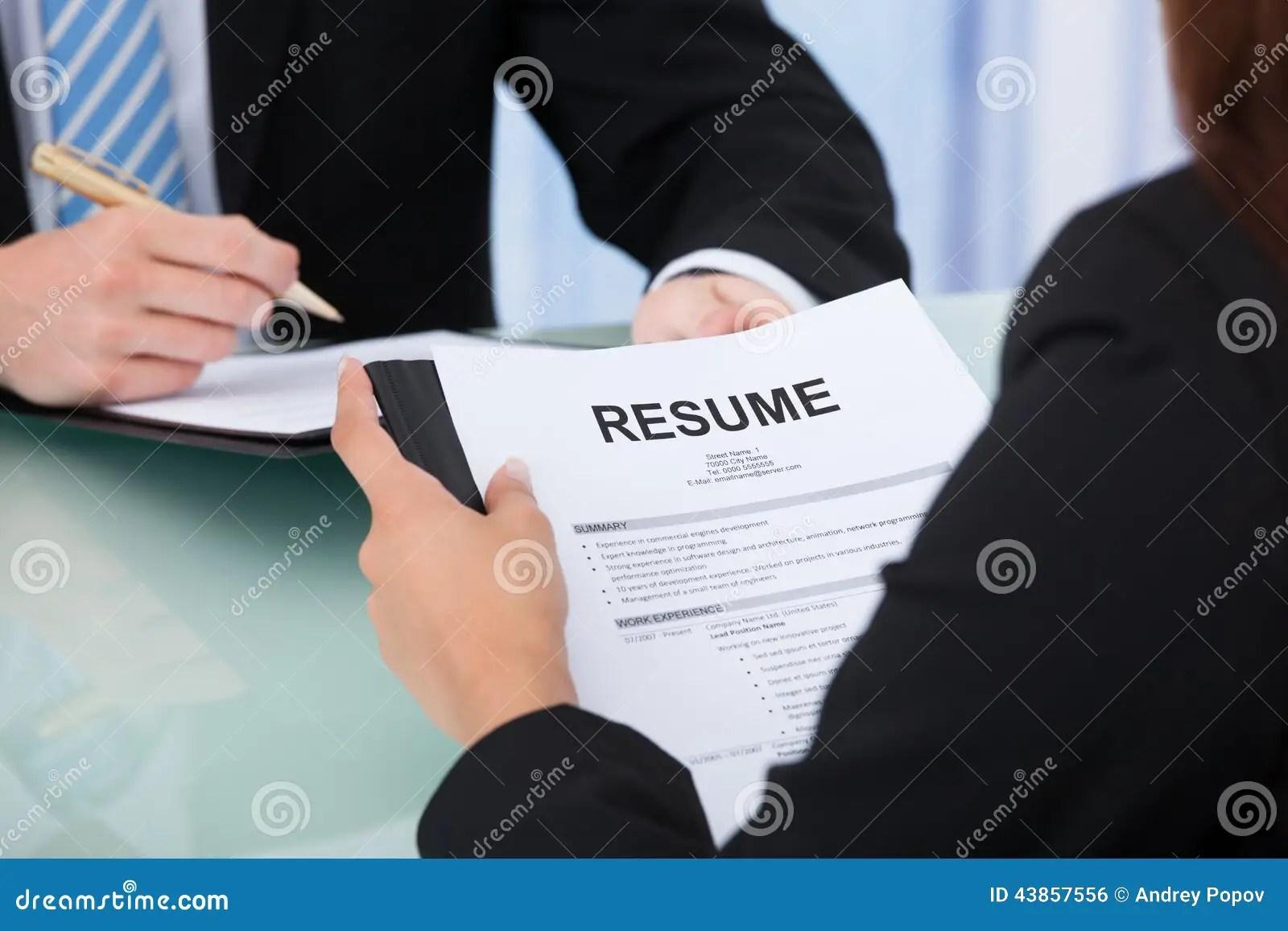 Female Candidate Holding Resume At Desk Stock Photo  Image 43857556
