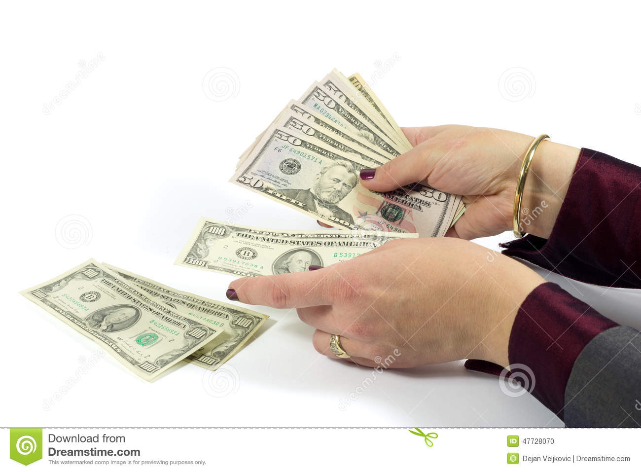 Female Hand Counting American Dollar Bills On White
