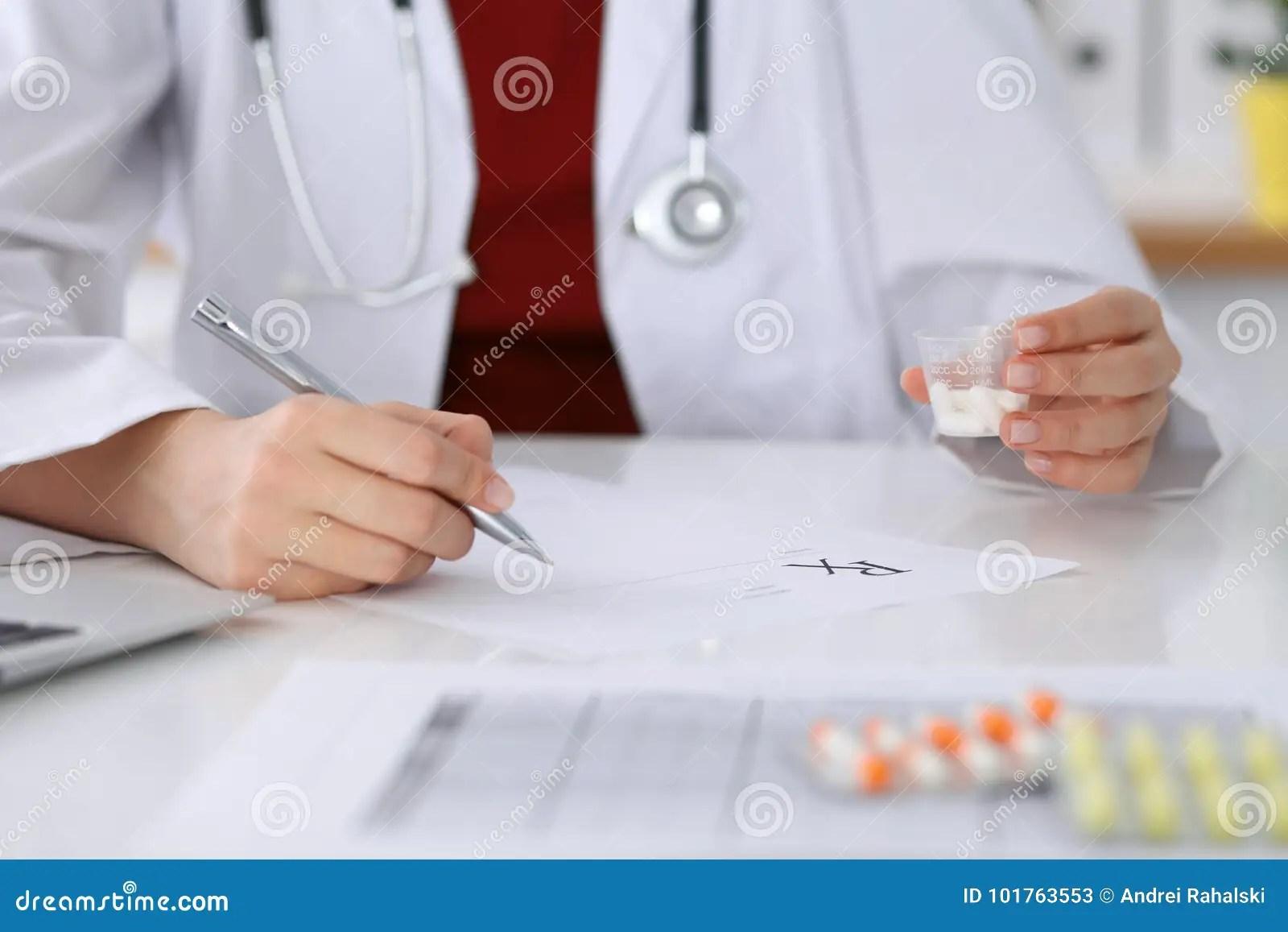 Female Medicine Doctor Fills Up Prescription Form To