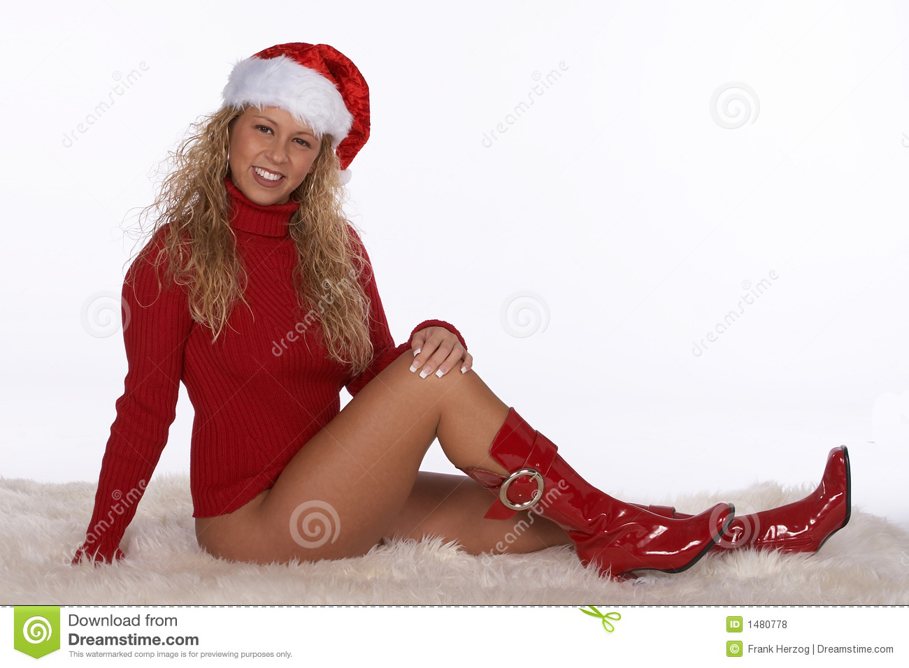 Female Santa In Red Sweater And Boots Lying On Fur Rug
