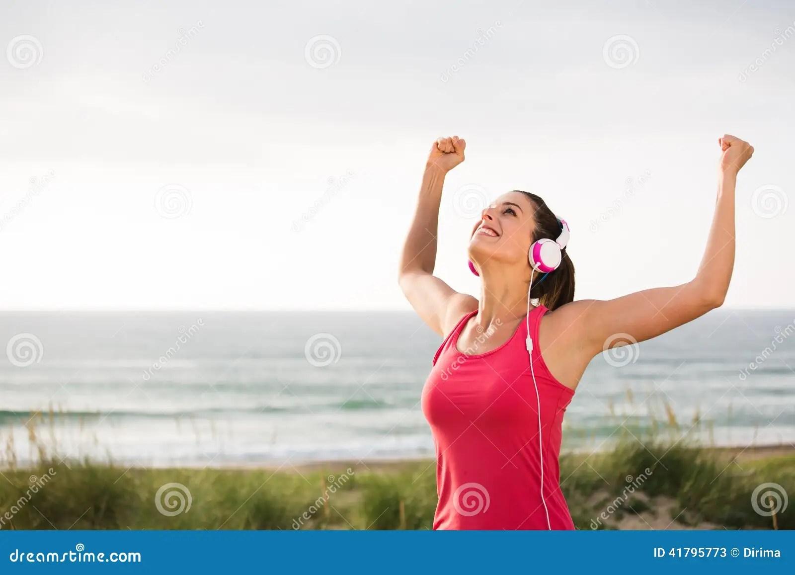 Female Successful Athlete Celebrating Fitness Goals Stock