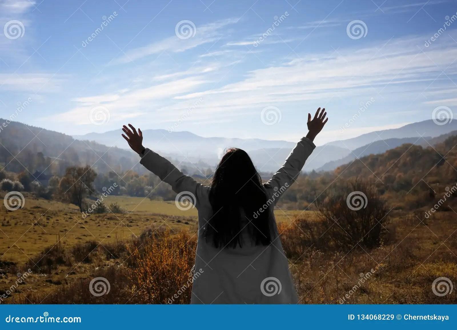 female traveler feeling free