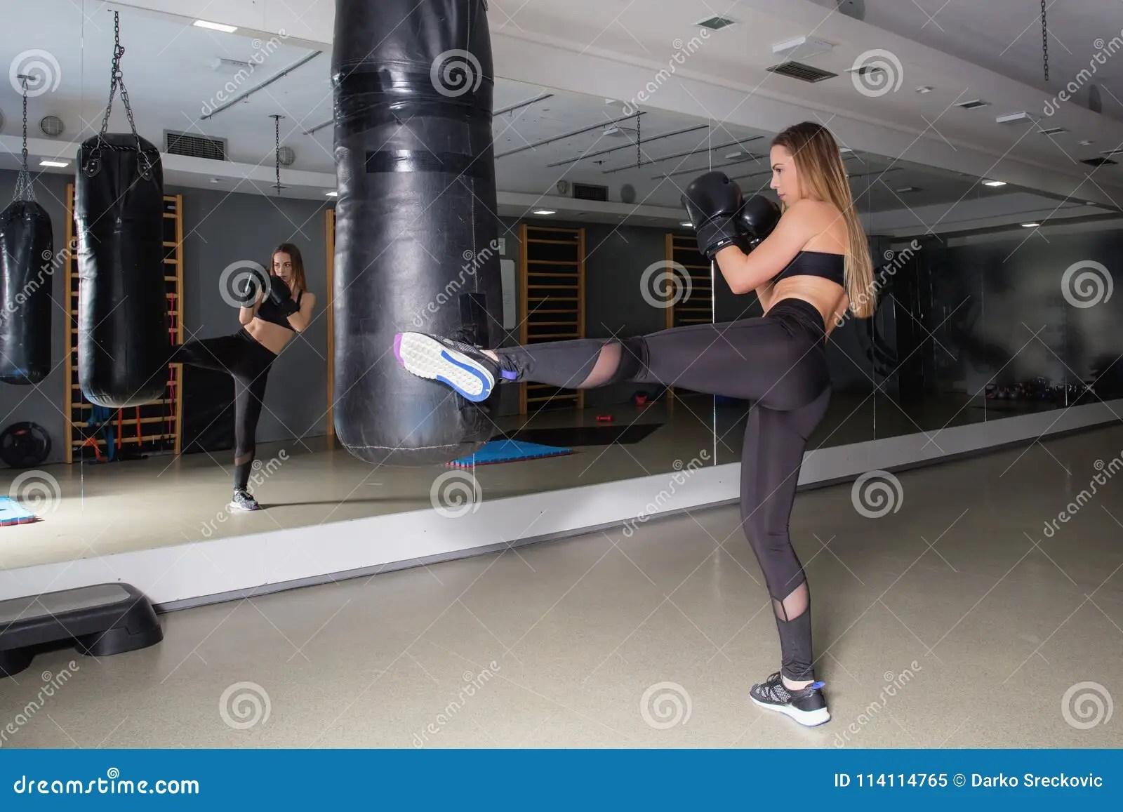 fitness girl kicking at