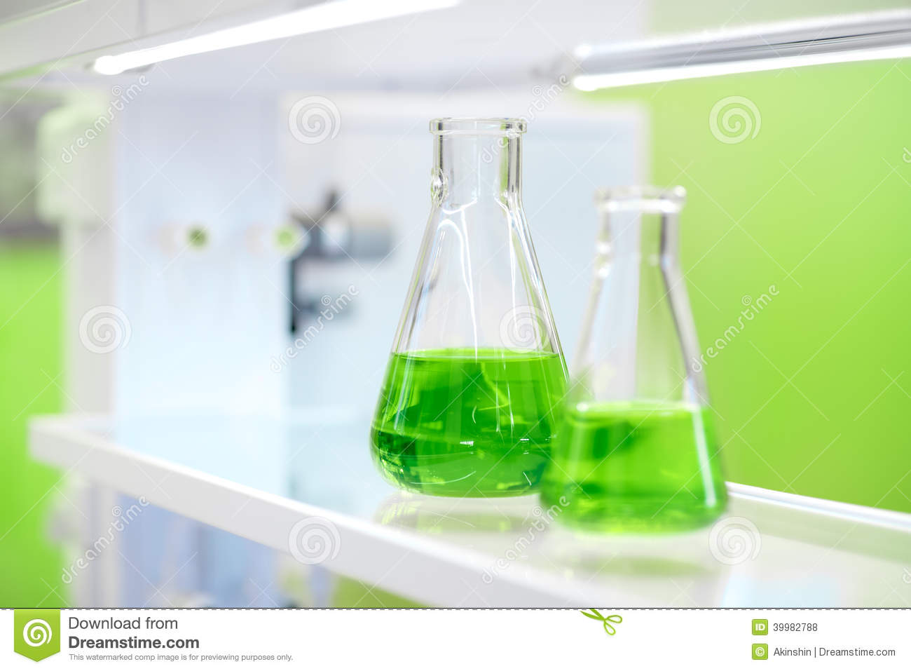 Flasks With Green Liquid In A Chemistry Lab Stock Photo