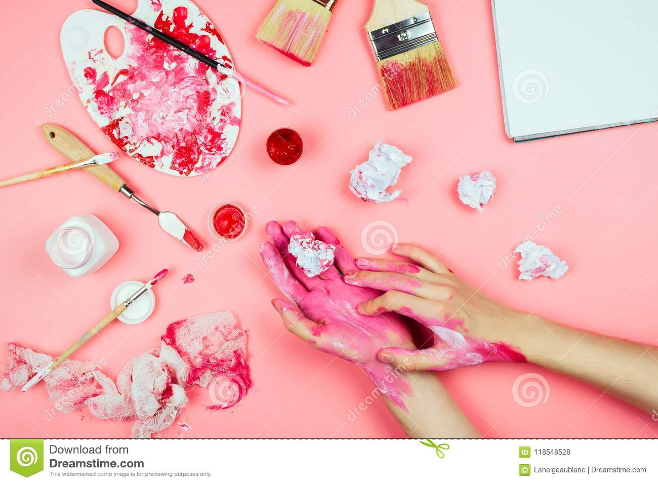 Flatlay With Woman S Hands Covered In Paint Holding Brush