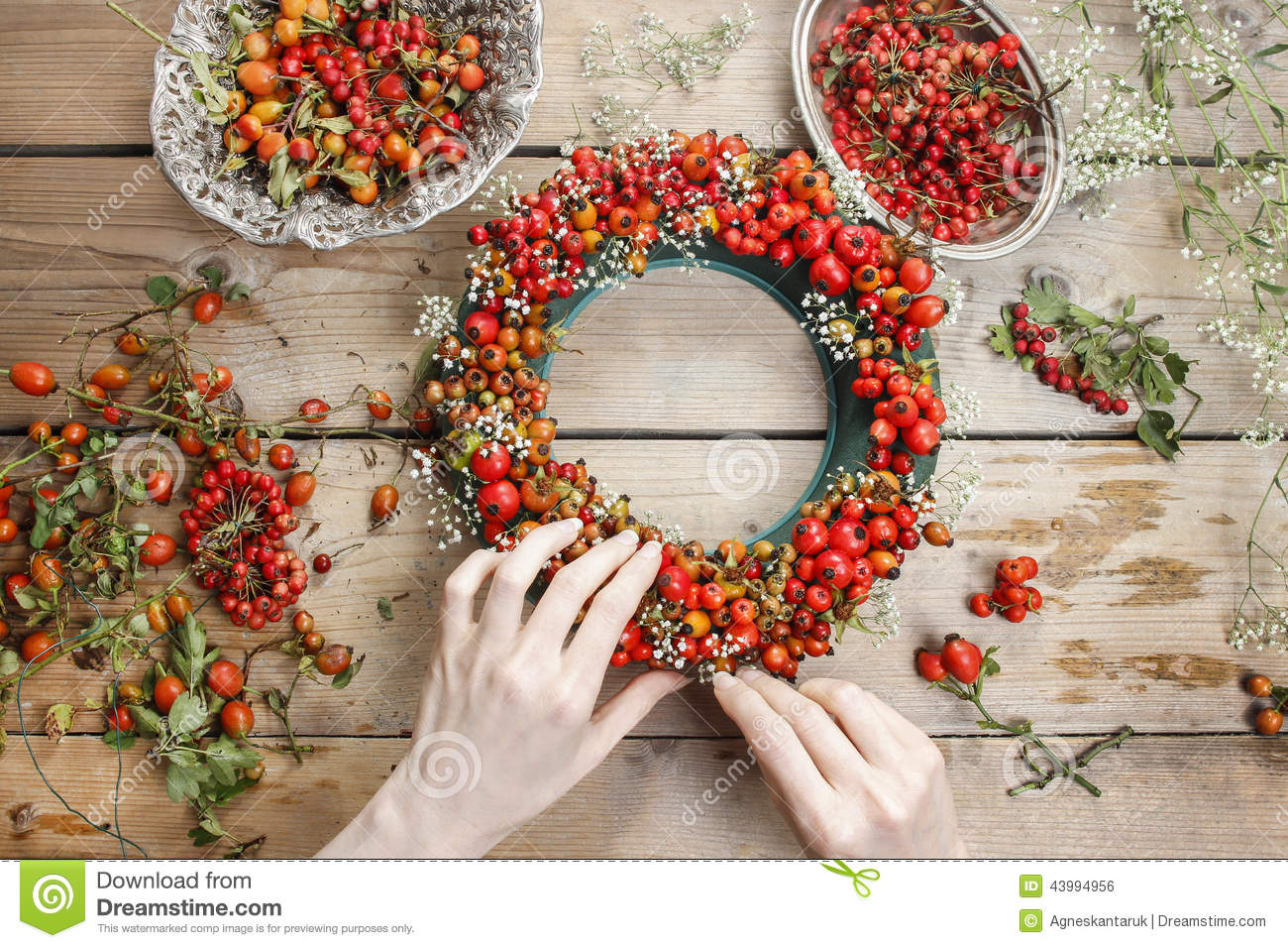 Florist At Work Woman Making Rose Hip And Hawthorn Wreath