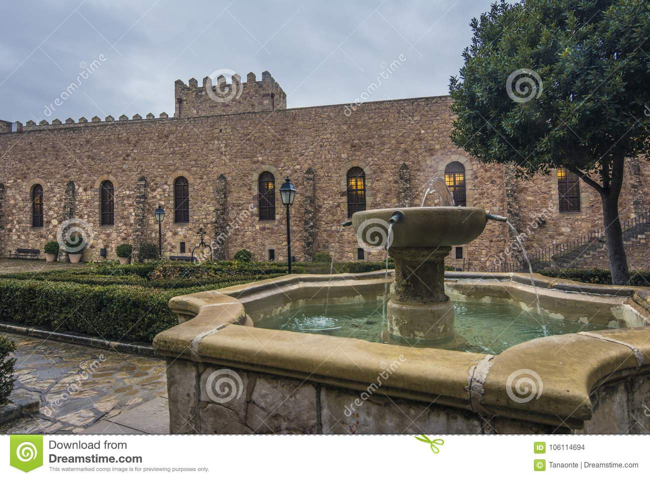 Fountain And Castle Walls Of Siguenza Spain Stock Photo