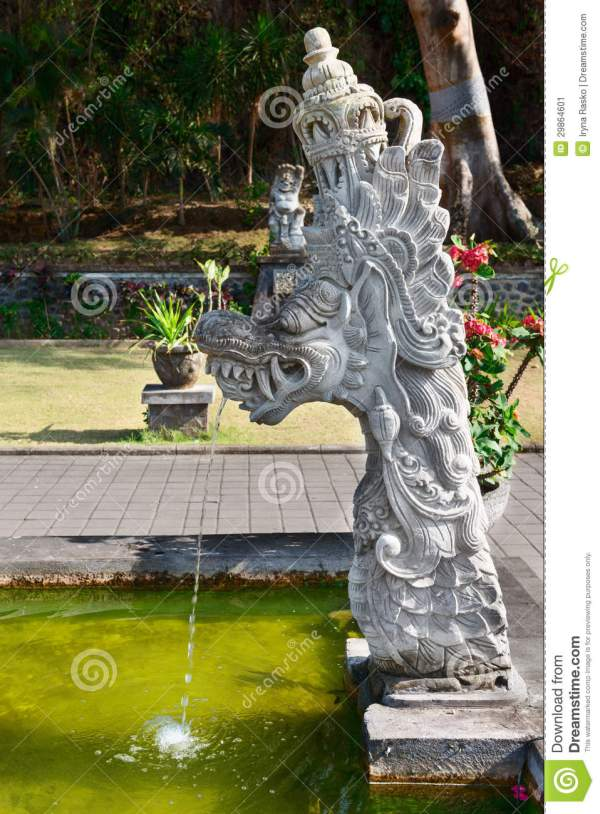 Fountain With Traditional Balinese Stone Dragon Statue Stock - 29864601