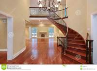 Foyer With Balcony And Curved Staircase Royalty Free Stock ...