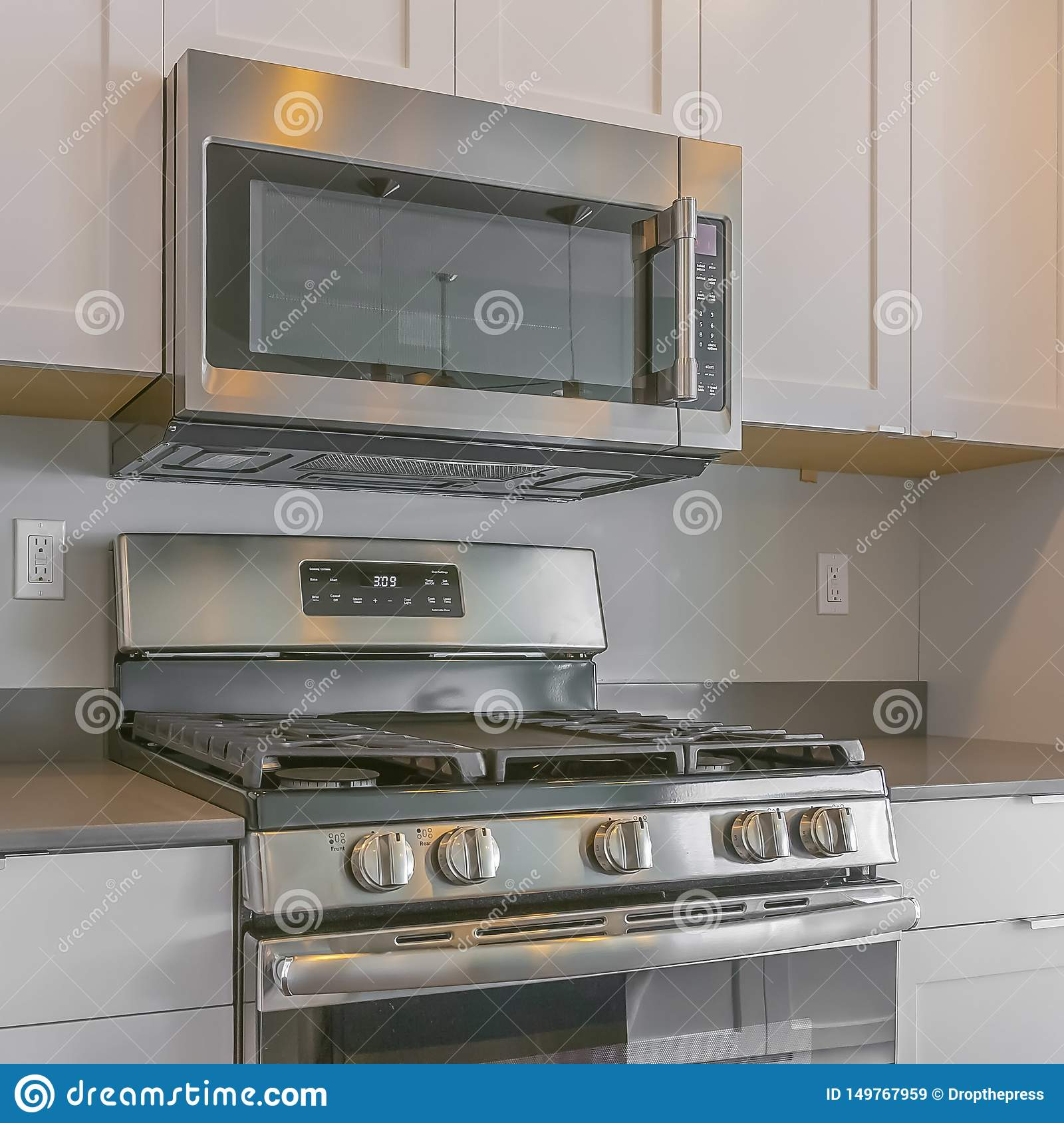 https www dreamstime com frame square cooking range wall mounted microwave inside modern kitchen white wooden cabinets built s light gray image149767959