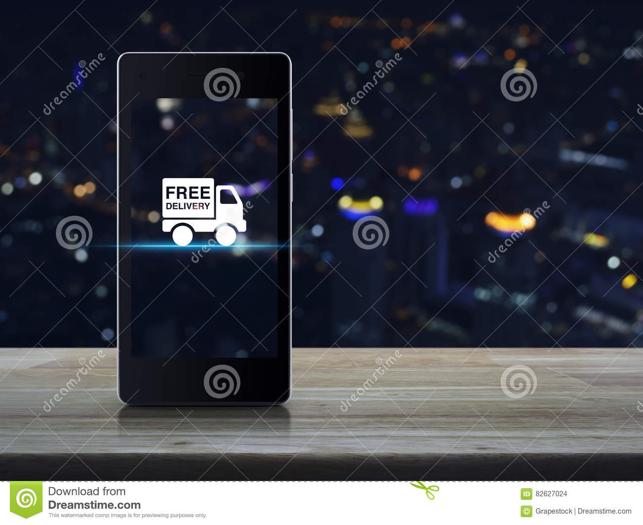 hight resolution of free delivery truck icon on modern smart phone screen on wooden table in front of blurred light city tower transportation business concept