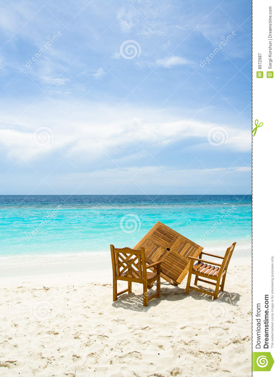 wooden beach chairs plans wheelchair jeep free table for two on the with ocean view stock image - of blue, leisure: 8972987