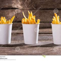 Kitchen Bistro Table Rubbermaid Trash Cans French Fries In Cups. Stock Photo - Image: 70405973
