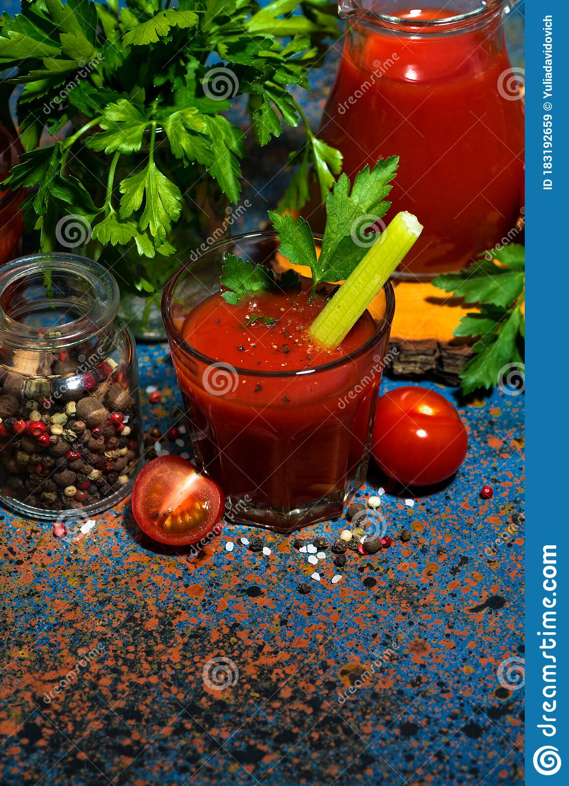 Fresh Tomato Juice With Salt And Celery On Dark Table ...