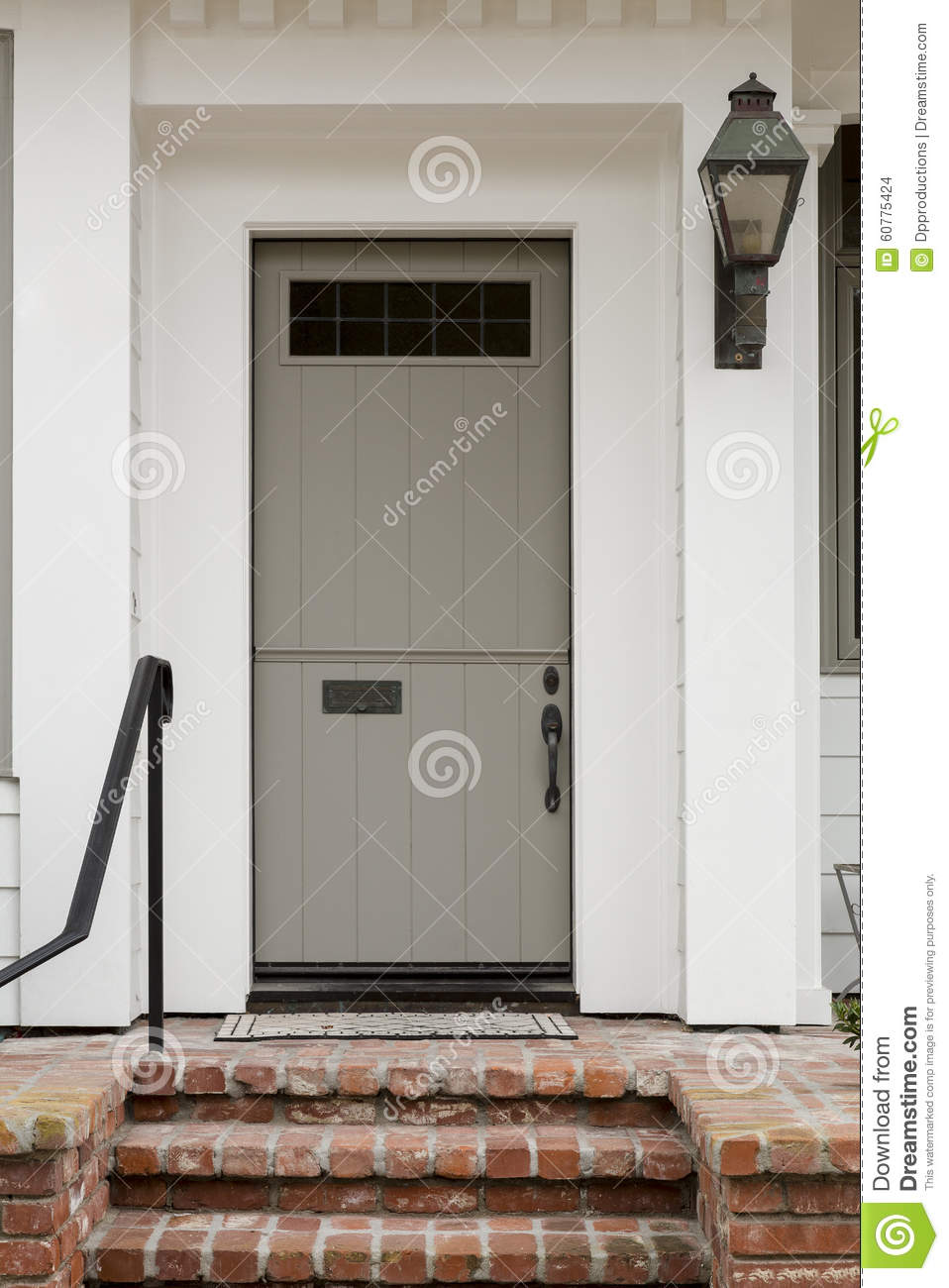 Front Door With White Exterior And A Large Porch Light With Brick Staircase Stock Photo  Image