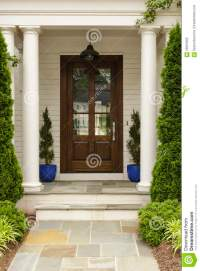 Front Door With White Pillars Stock Photo