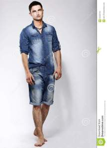 Full Length Portrait Of Young Confident Barefoot Man In
