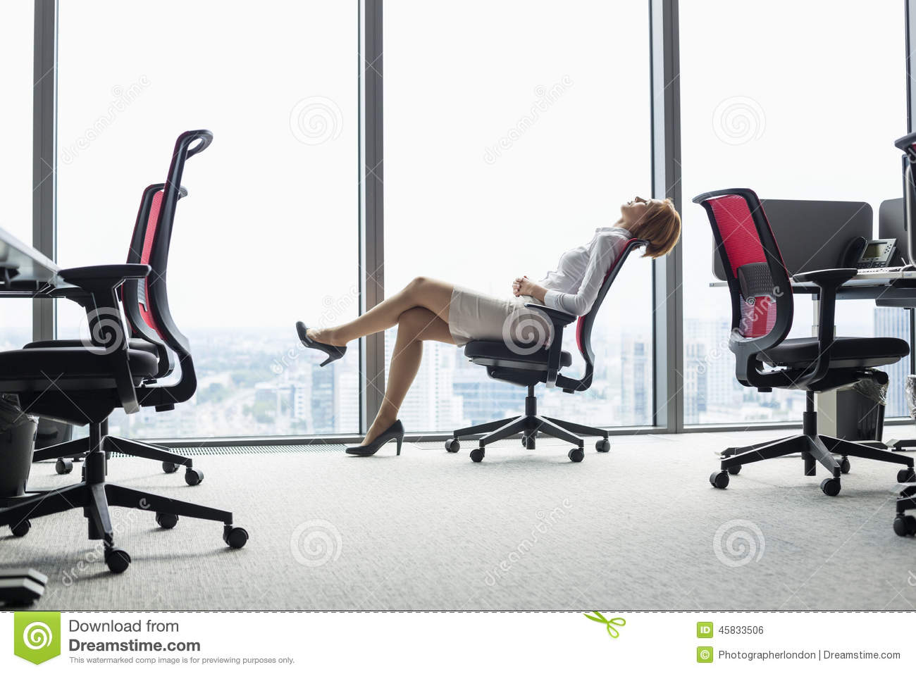 office chair leaning to one side amazon bar covers full length view of young businesswoman back