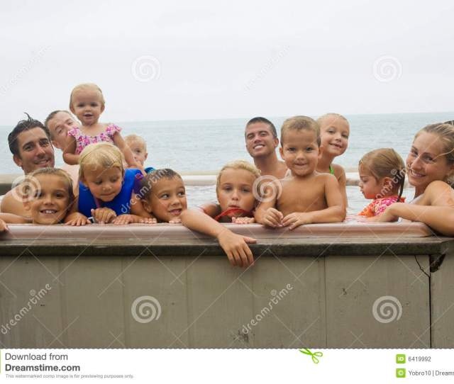 Cousins Nieces Nephews Aunts And Uncles All Having Fun Together As A Family In The Hot Tub While At A Family Reunion
