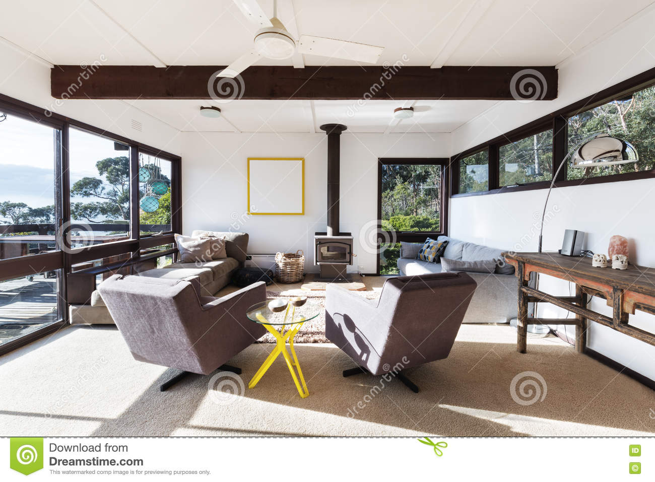 Funky Retro Beach House Living Room With 70s Style Chairs